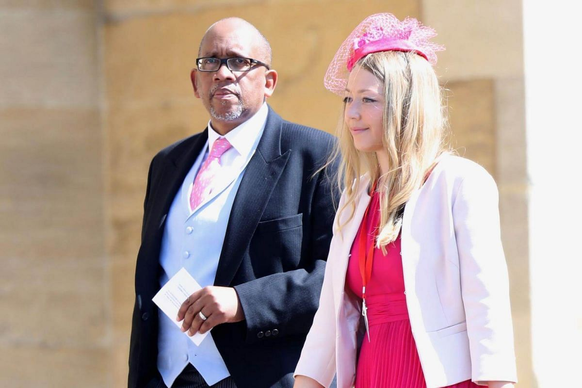 Prince Seeiso of Lesotho (left) arrives for the wedding ceremony at St George's Chapel, on May 19, 2018.