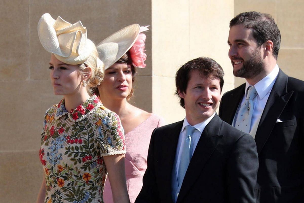 Singer James Blunt (centre) and his wife Sofia Wellesley arrive for the royal wedding ceremony at St George's Chapel on May 19, 2018.