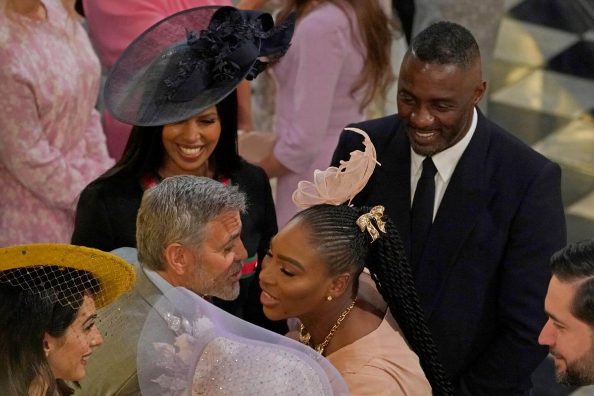 Actor George Clooney greets tennis champion Serena Williams as actor Idris Elba and his wife Sabrina Dhowre look on in St George's Chapel at Windsor Castle on May 19, 2018.