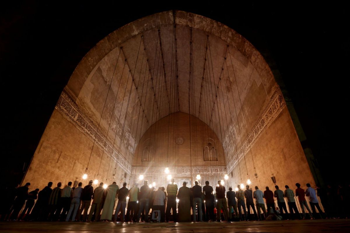 "Egyptian Muslims perform evening prayers called ""Tarawih"" inside Al Sultan Hassan mosque during the Muslim holy fasting month of Ramadan in the old Islamic area of Cairo, Egypt May 20, 2018."