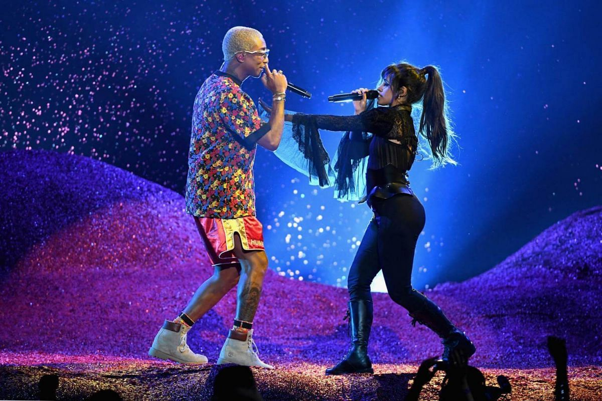 Pharrell Williams (left) and Camila Cabello perform during the 2018 Billboard Music Awards, on May 20, 2018.