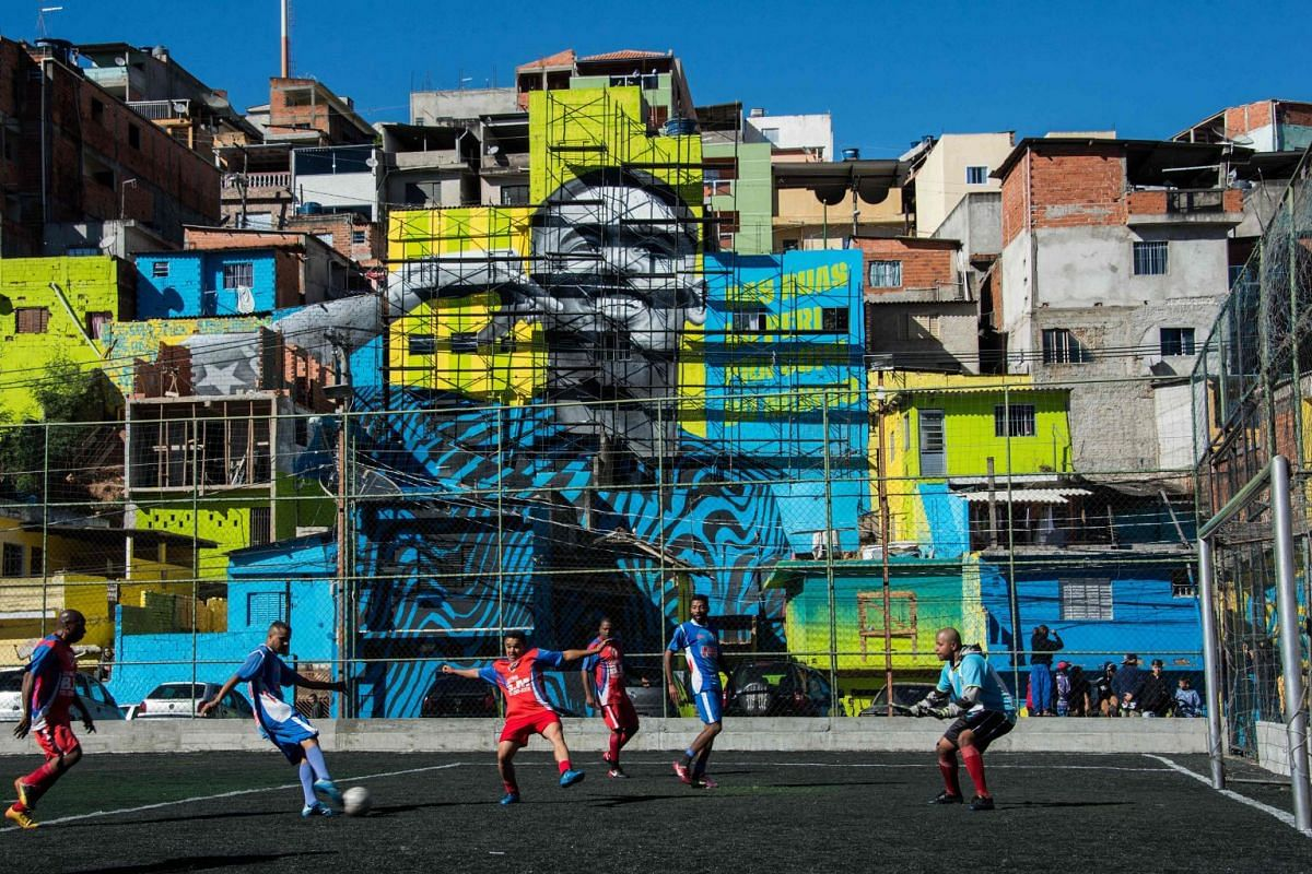 The image of Brazilian football player Gabriel Jesus is seen on the walls of houses in Peru´s neighbourhood, where he lived during his childhood in the outskirts of Sao Paulo, Brazil on May 20, 2018.