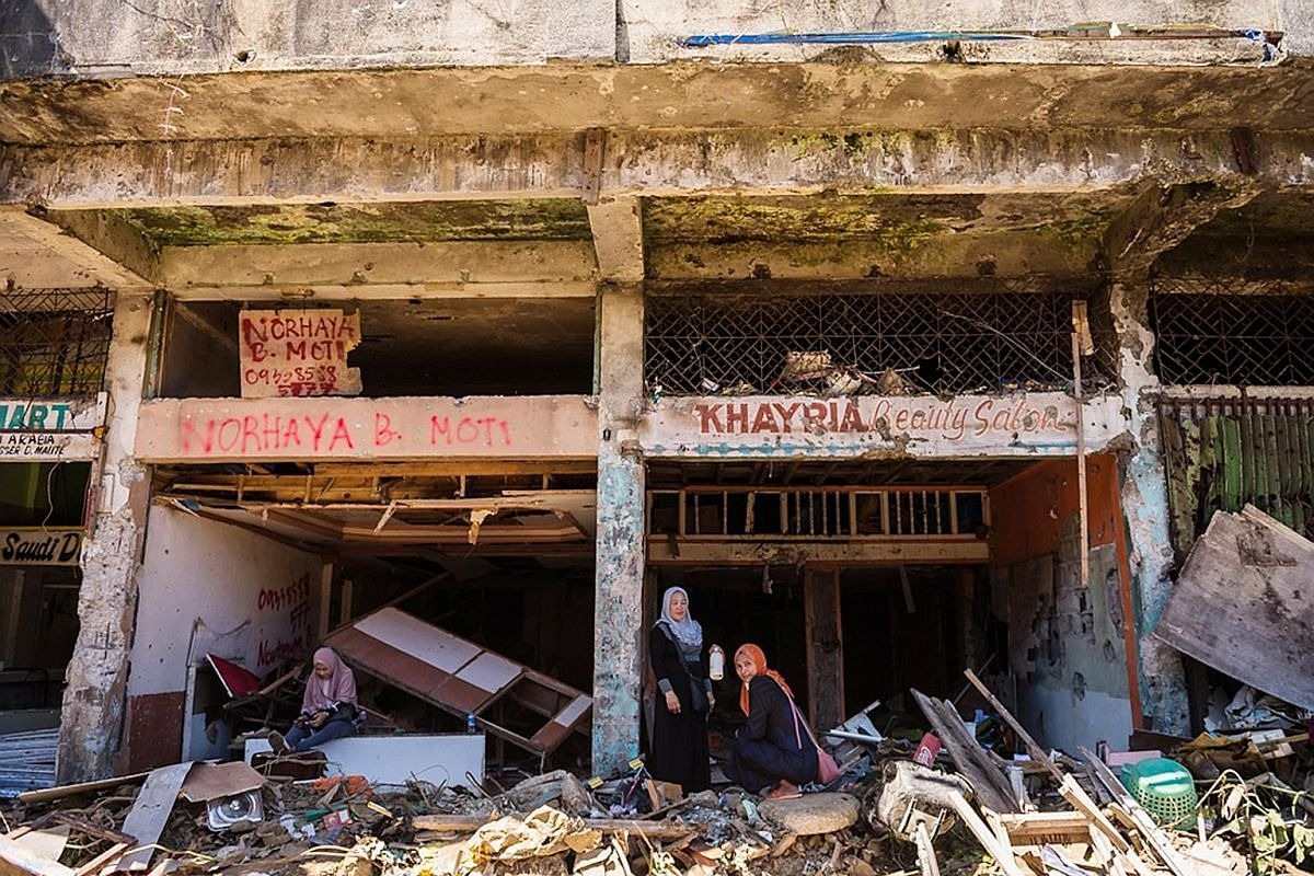 """An arch marking the entrance to Marawi, which is about a tenth the size of Singapore. In May last year, about 1,000 militants claimed the city for a """"caliphate"""" spanning thousands of kilometres. Since mid-April, residents have been allowed to return"""
