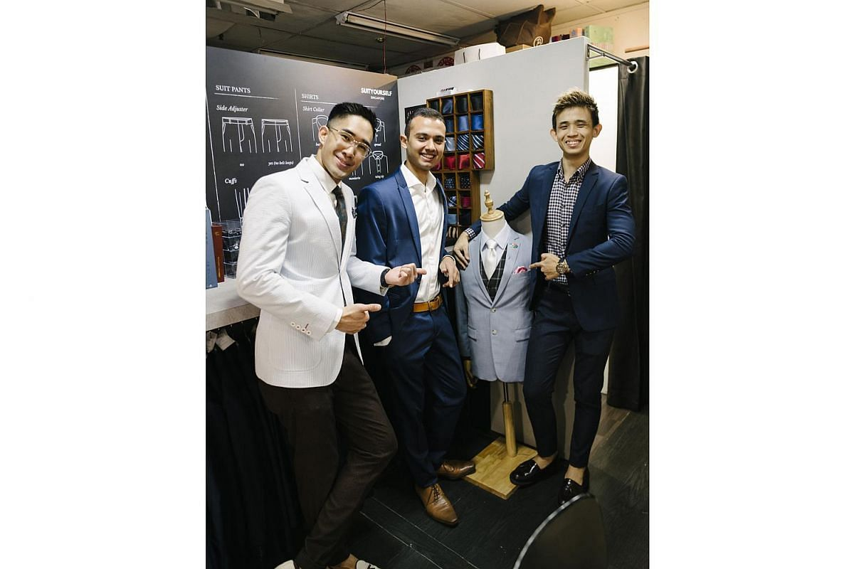 SuitYourself Singapore hires student ambassadors such as Mr Siddarth Bhatia (centre) and Mr Lester Quek (right). They are with Mr Shaun Chua, a marketing executive with the business.