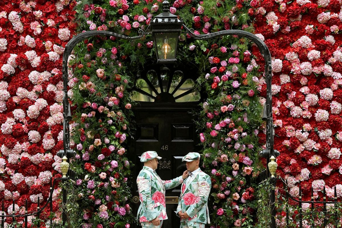 Doormen dressed in floral pattern suits stand on duty outside of Annabel's private members club, adorned with thousands of flowers, timed to coincide with the RHS Chelsea Flower Show, in Mayfair in London, Britain, May 24, 2018.