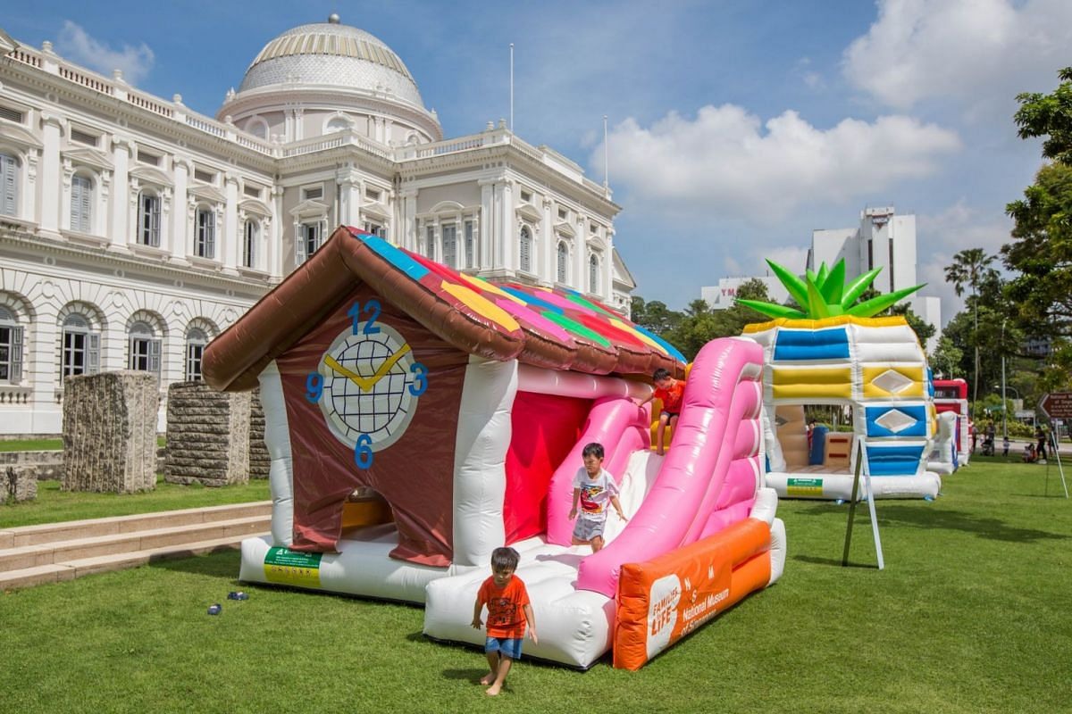 Children can have fun on bouncy inflatables at the National Museum of Singapore's front lawn.