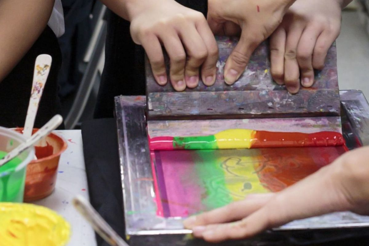 Kids can create their own designs at the printing workshop.