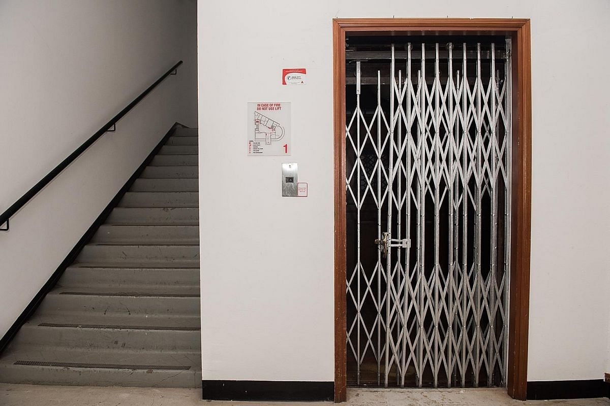The lift, which was built and installed by British company Smith, Major and Steven, has (from left) wooden panelling, a collapsible iron gate and steel weights. The building was Singapore's first Modernist building. The building at 5 Kadayanallur Str