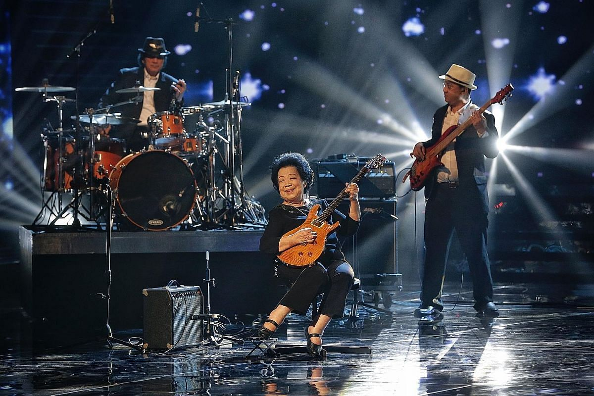 Retired cook Wong Wing Cheong, 91, cooks daily for himself and his wife. Madam Mary Ho, 82, also known as Grandma Mary, playing the electric guitar at the Community Chest Charity TV Show last week. She picked up the electric guitar at about 65. Madam