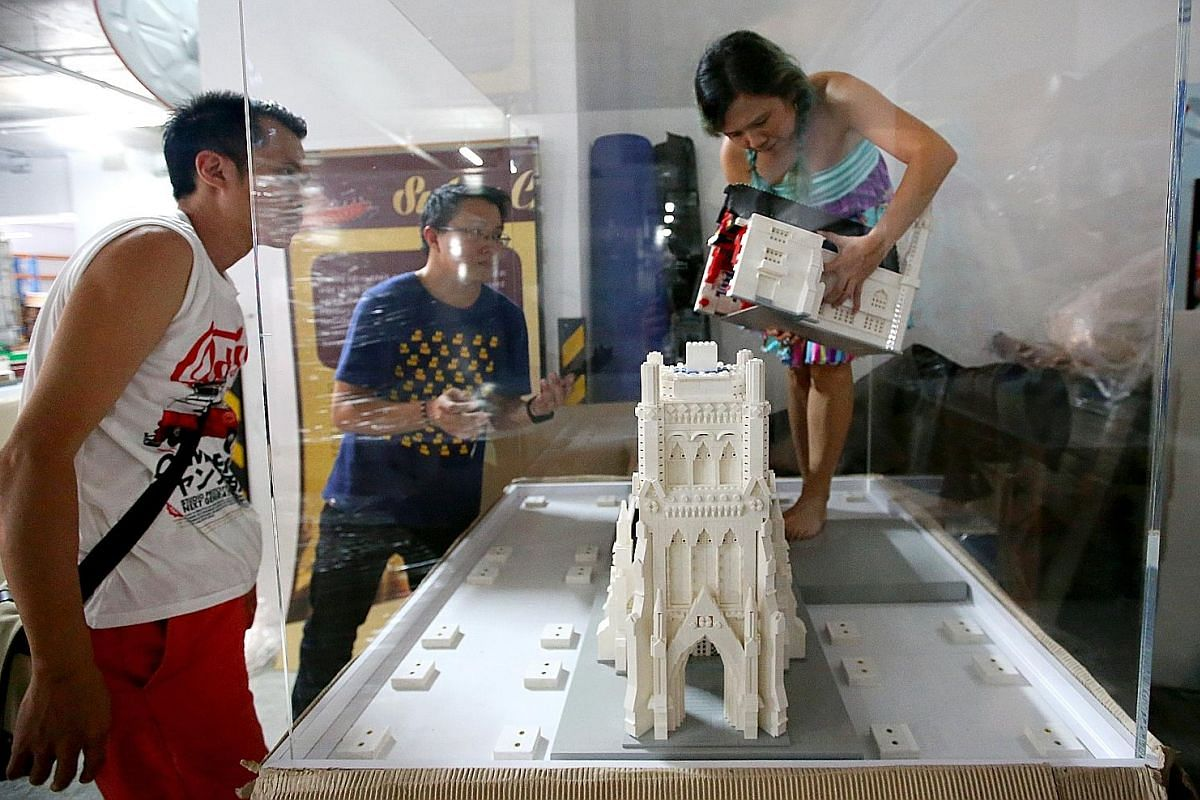 Ms Xylvie Wong building part of the National Museum facade. There are 107 windows in this model. She designed the windows to protrude out by half a stud, which made building them very tedious. Although it is quite repetitive, she sometimes forgot how