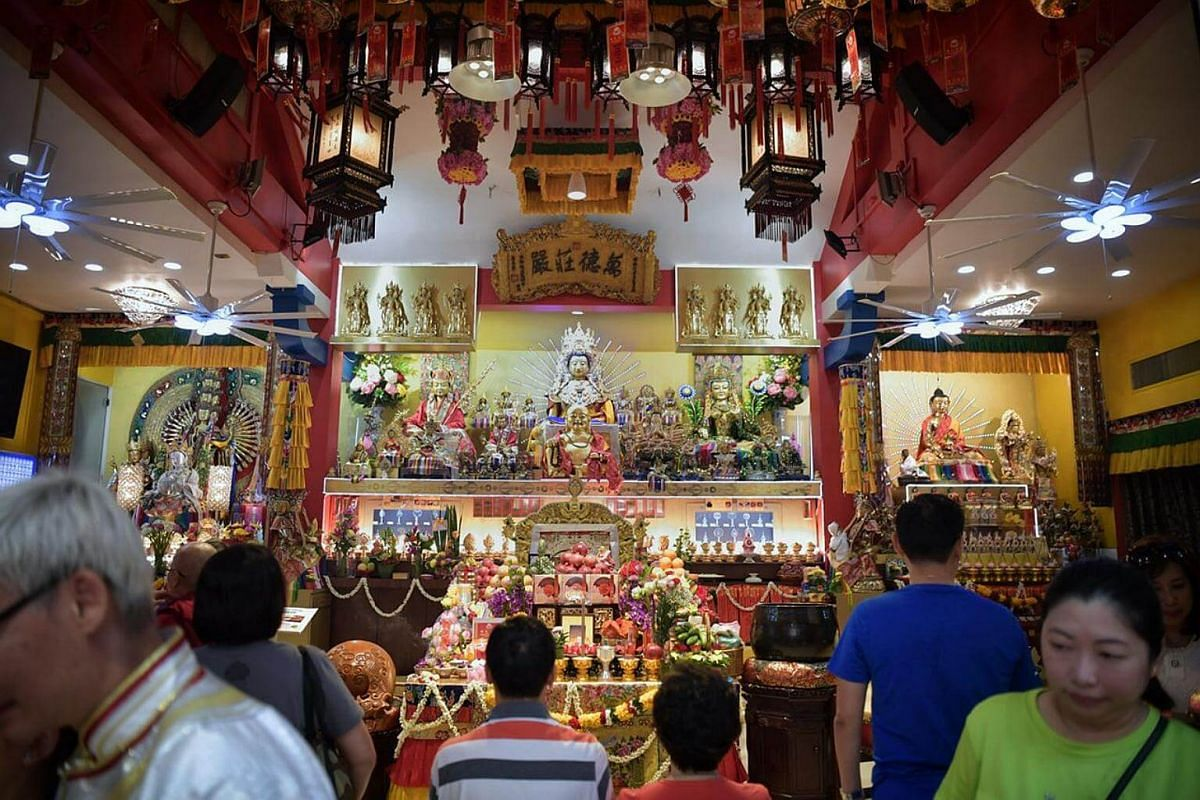 Devotees marking Vesak Day at Thekchen Choling, Singapore's only 24-hour Tibetan Buddhist temple, on May 29, 2018.