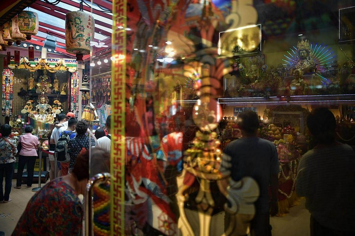A crowd of devotees seen at Tibetan Buddhist temple Thekchen Choling, on Vesak Day, which falls on May 29, 2018.