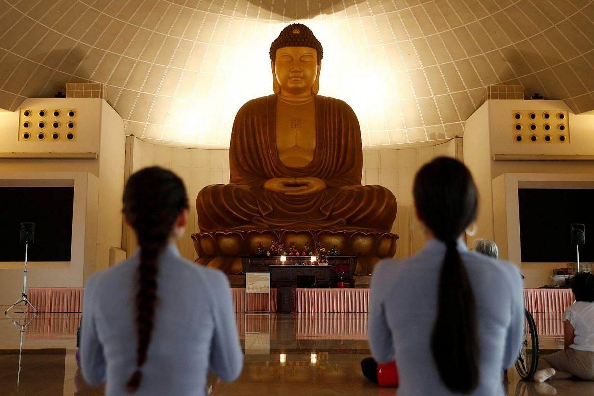 Devotees praying ahead of Vesak Day at the Kong Meng San Phor Kark See Monastery, on May 28, 2018.