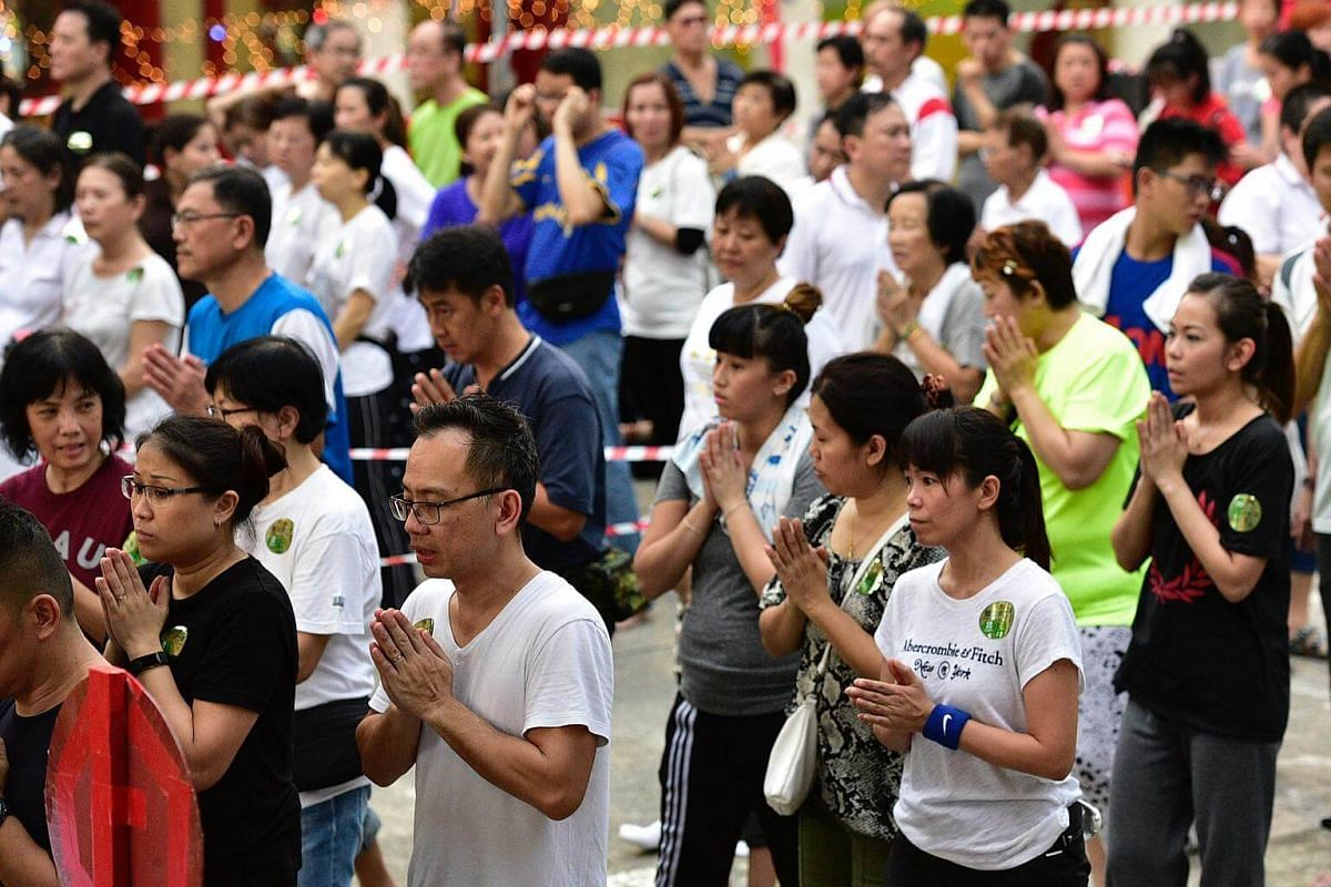 Devotees engaging in prayer at the Kong Meng San Phor Kark See Monastery, on May 28, 2018, ahead of Vesak Day.