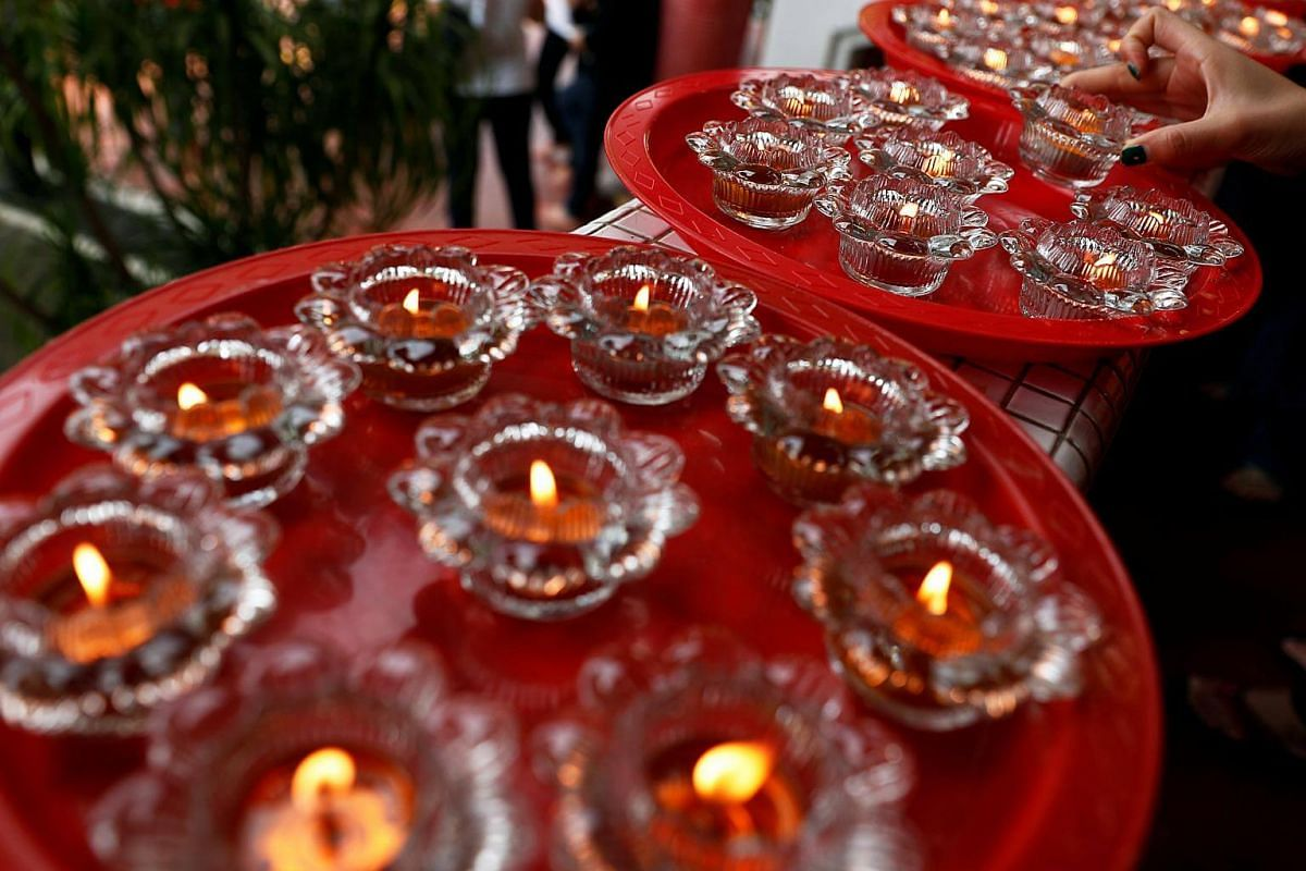 A devotee offers candles ahead of Vesak Day at the Kong Meng San Phor Kark See Monastery, on May 28, 2018.