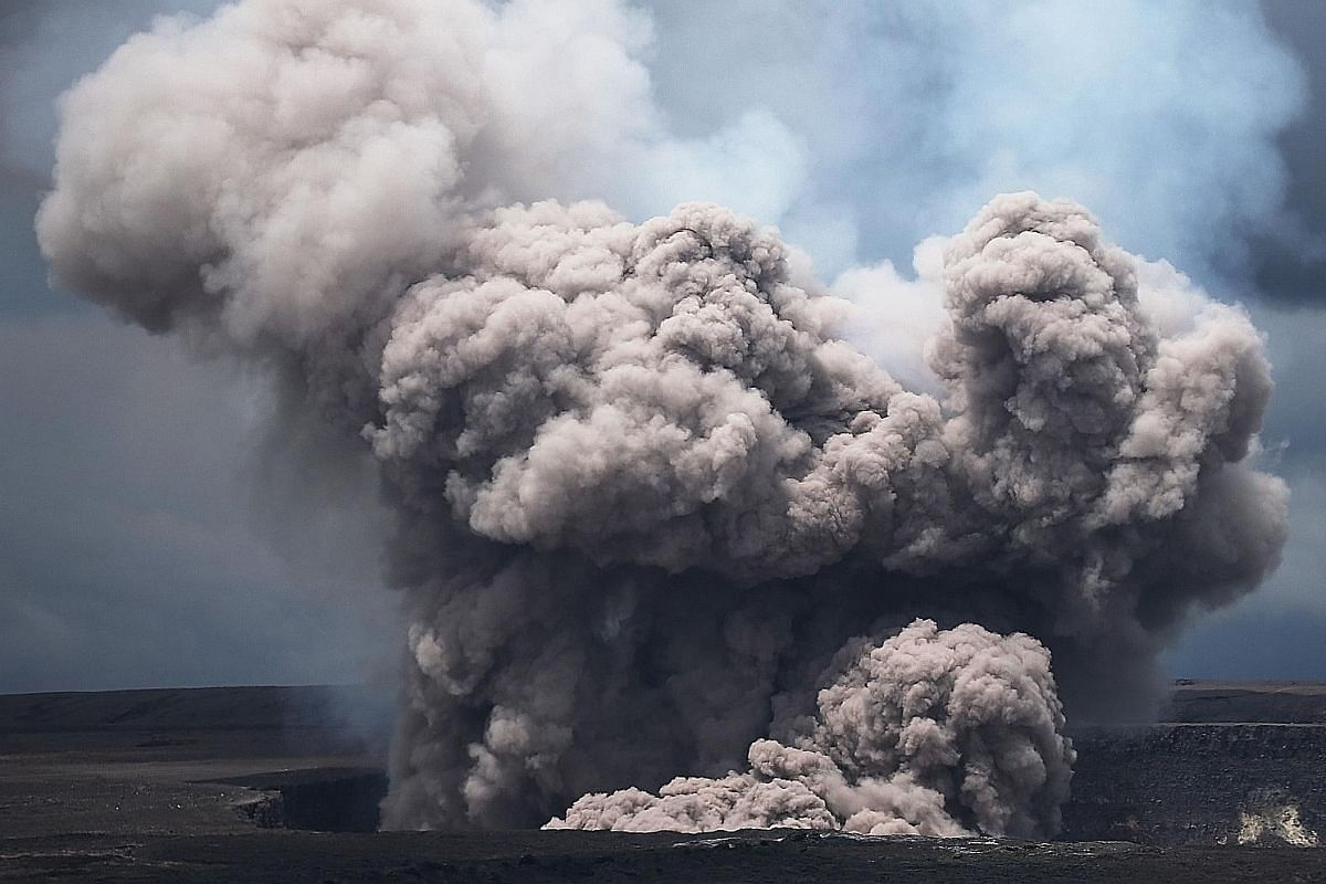 WHAT GASES ARE EMITTED DURING AN ERUPTION? US Army National Guard First Lieutenant Aaron Hew Len takes measurements for sulphur dioxide gas at volcanic fissures in Pahoa on May 8. Many different gases are emitted into the air during a volcanic erupti
