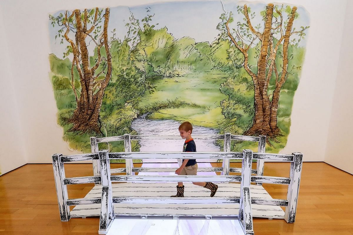 A young boy walks over a bridge in the 'Hundred Acre Wood' during a preview of 'Winnie-the-Pooh: Exploring a Classic' exhibit at the High Museum of Art in Atlanta, Georgia, USA, May 31, 2018. The exhibit, which runs from June 03 to September 02, is t