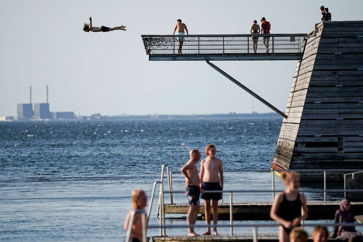 A young man dives off a diving tower at the Titanic Pier in Malmo, southern Sweden May 31, 2018. Photo: TT News Agency via REUTERS