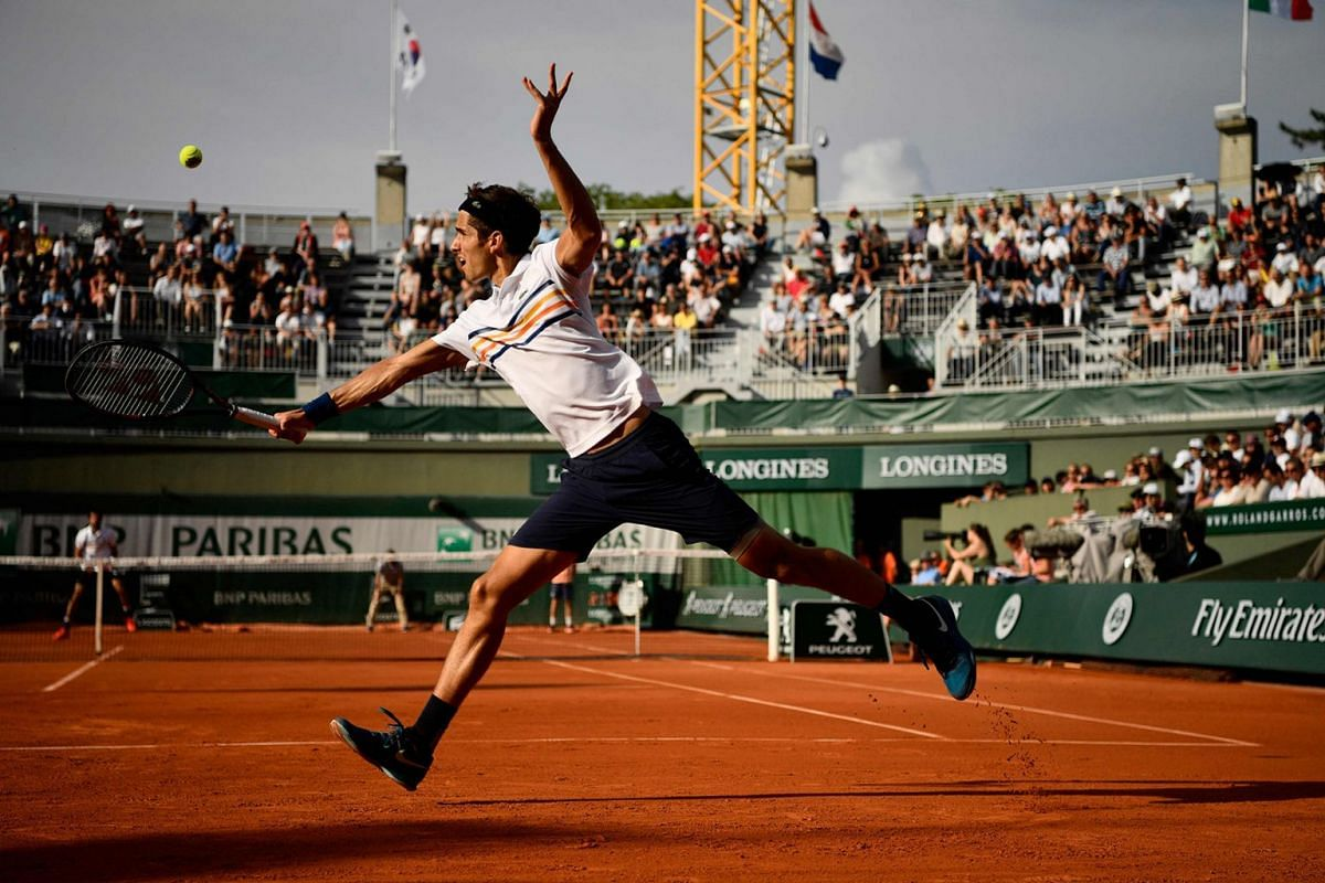 France's Pierre-Hugues Herbert returns the ball to France's Jeremy Chardy during their men's singles second round match on day five of The Roland Garros 2018 French Open tennis tournament in Paris on May 31, 2018. Photo: AFP