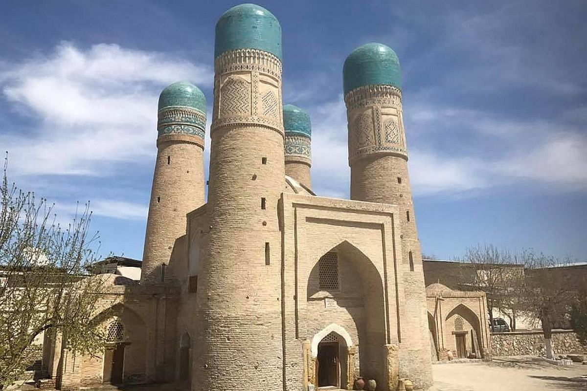 (From left) Pilgrims in Khiva; a madrasa converted into a small market; spices on sale in Bukhara; and the Oriental Silk Road Express, which the writer travelled on. (Clockwise from left) Khiva, a walled, fortress-like town in Uzbekistan; the stunnin
