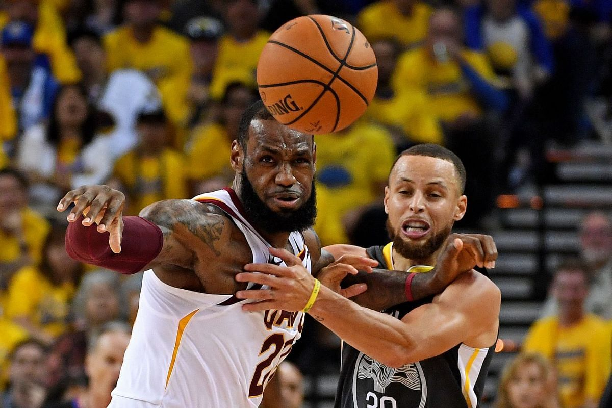 Golden State Warriors guard Stephen Curry (30) and Cleveland Cavaliers forward LeBron James (23) go for a loose ball during the second quarter in game one of the 2018 NBA Finals at Oracle Arena on June 3, 2018; Oakland, CA, USA. PHOTO: USA TODAY SPOR