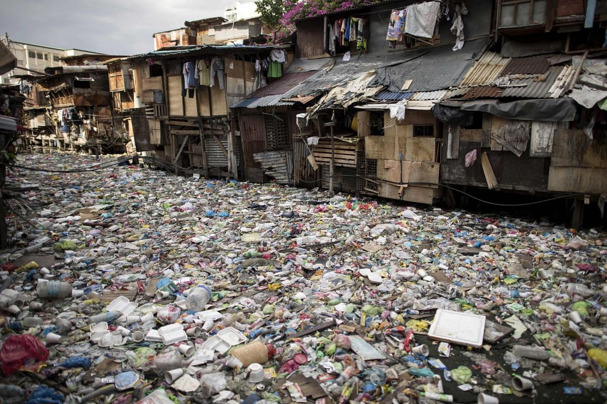 """A photo released on June 5, 2018 shows a garbage-filled creek in Manila, May 12, 2018. Today marks World Environment Day and the theme is """"Beat Plastic Pollution"""". PHOTO: AFP"""