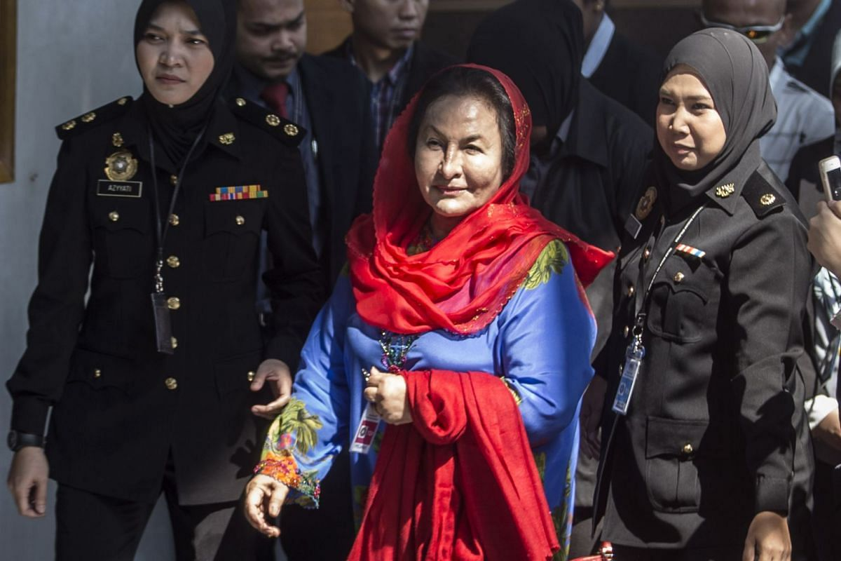 Rosmah Mansor (C), wife of former Malaysia Prime Minister, is escorted by authorities as she arrives at the Malaysian Anti-Corruption Commission (MACC) headquarters in Putrajaya, Malaysia, June 5, 2018. PHOTO: EPA-EFE