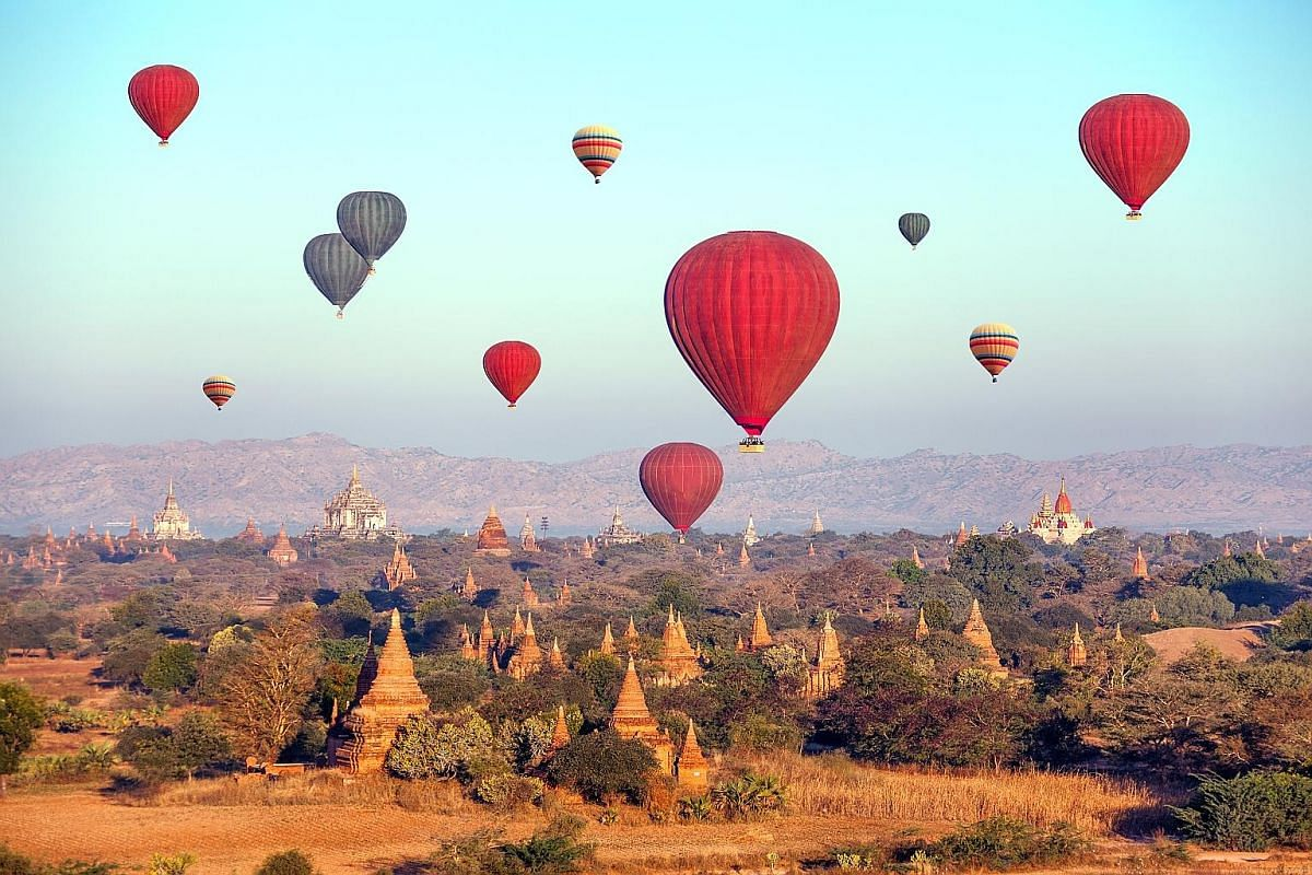 Hot-air balloons over Buddhist temples in Myanmar's Bagan. Such tours are also offered to tourists at Inle Lake, but wildlife officials prefer to scrap them, as the hot-air balloons affect the migratory birds there. More tourists are flocking to Myan