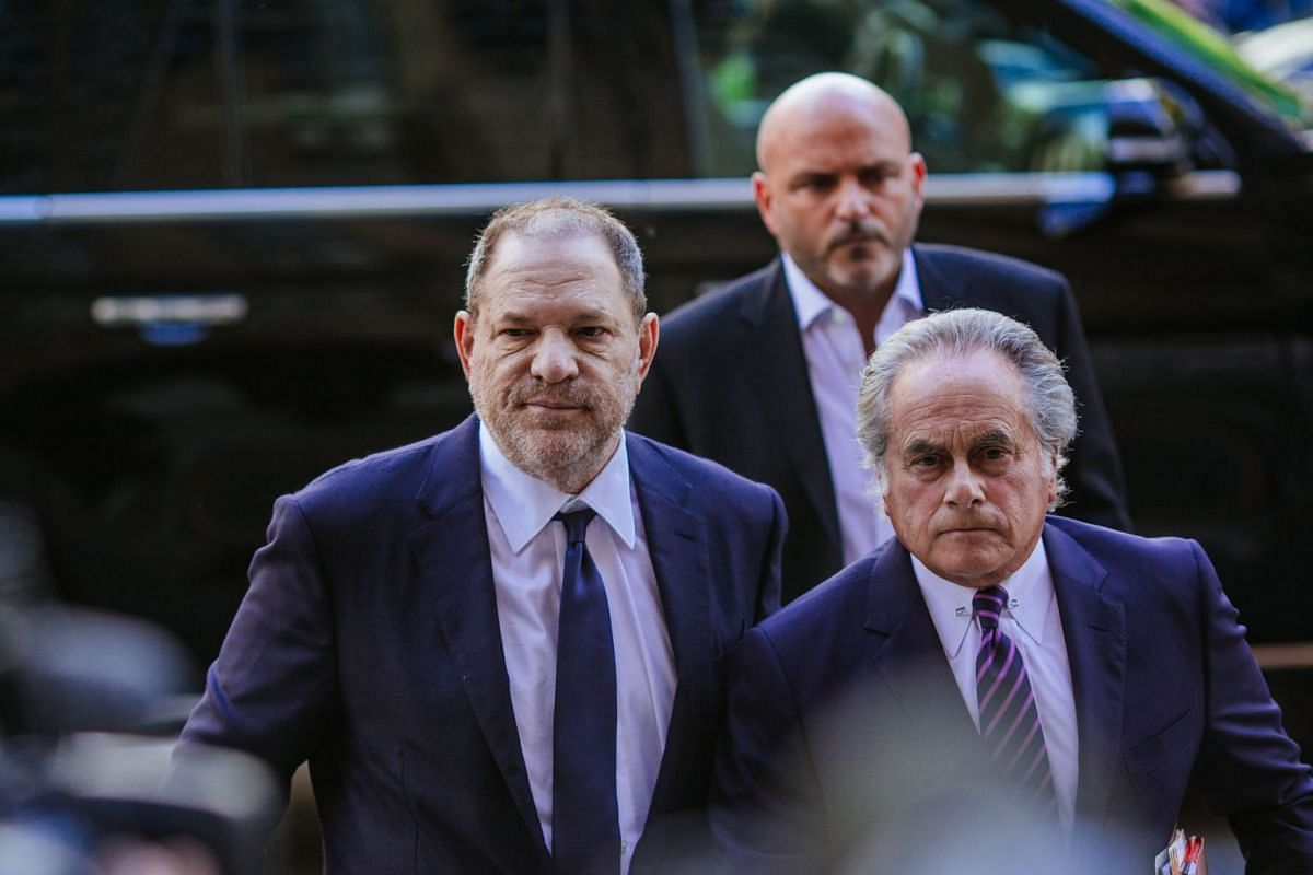Harvey Weinstein (L) arrives at State Supreme Court with attorney Benjamin Brafman following Weinstein's arraignment on June 5, 2018 in New York City. The former movie producer faces charges in connection with accusations made by aspiring actress Luc