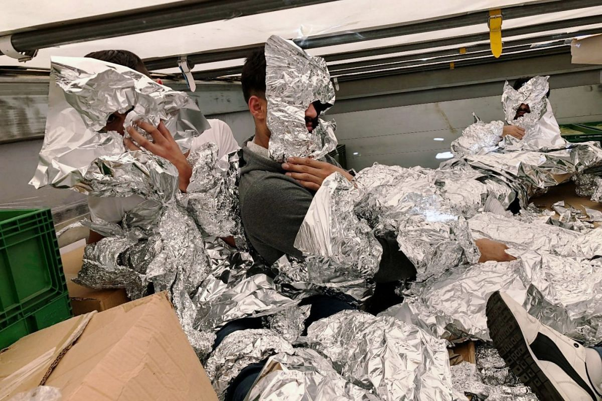 3 of the 7 Iraqi refugees wraped in aluminium foil to hide from an x-ray detector are pictured inside a truck at Pendik Port as they try to reach Italy in Istanbul, Turkey, June 6, 2018. PHOTO: DEPO PHOTOS VIA REUTERS