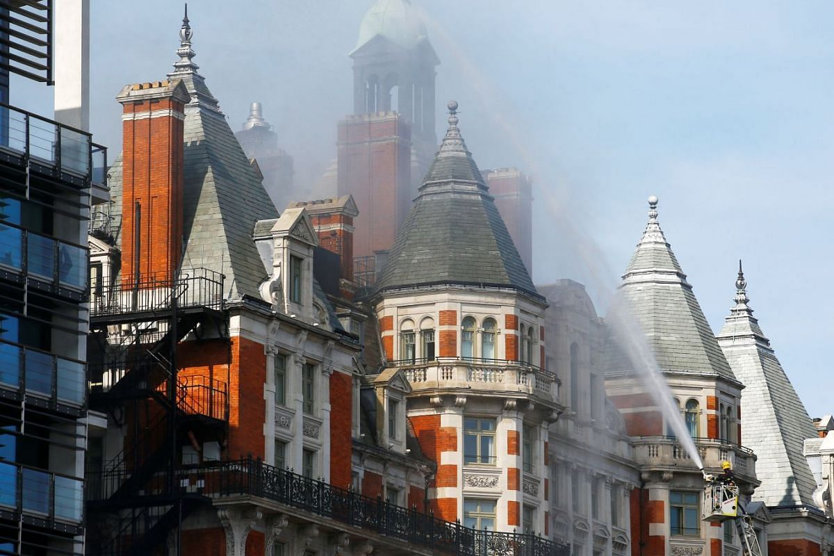 Firefighters tackle a blaze at the Mandarin Oriental Hotel in Knightsbridge, central London, Britain, June 6, 2018. PHOTO: REUTERS