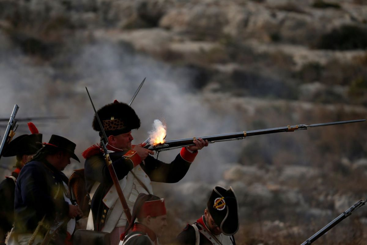 Napoleonic French re-enactors fire on Maltese defence positions during a re-enactment of the French invasion of Malta in 1798, at Mistra Bay outside Mellieha, Malta June 6, 2018. PHOTO: REUTERS