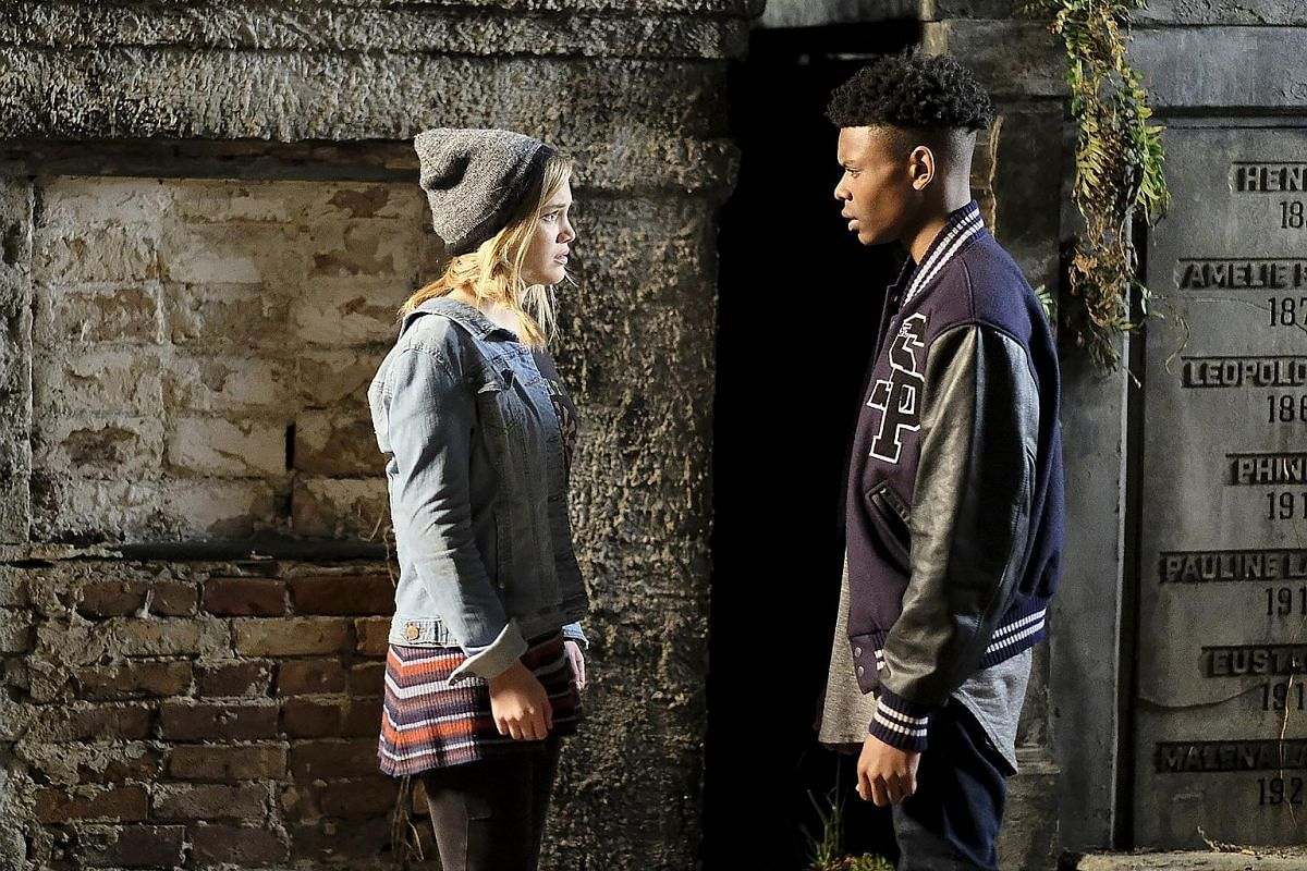 Olivia Holt and Aubrey Joseph (both left) play troubled teenagers with special abilities in Cloak & Dagger.