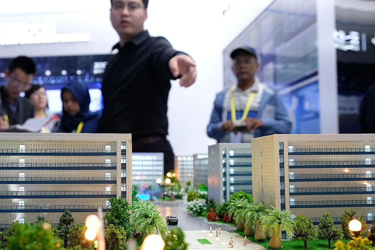 Employees of start-ups hard at work in Dream Town, an incubator zone in Hangzhou, capital of China's Zhejiang province. The zone offers entrepreneurs perks like rent-free premises and tax breaks to attract them to the city to start businesses. A work