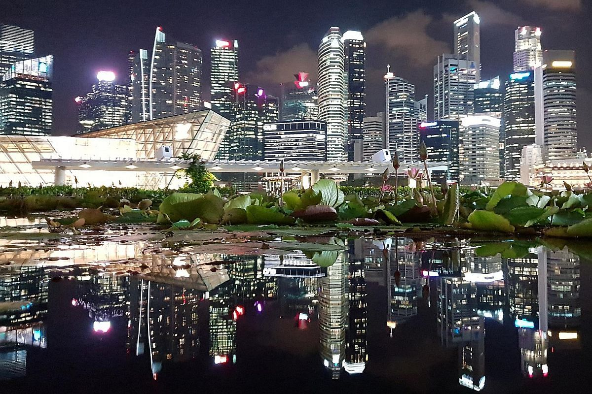 Singapore's glittering skyline offers photo opportunities to sightseers.