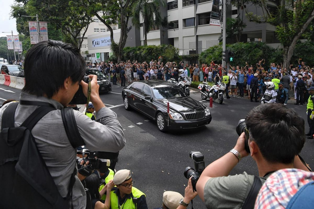 Mr Kim's convoy arrives at The St Regis as the assembled crowd scramble to take photos.