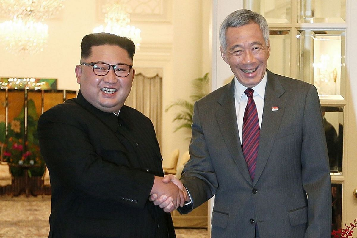 North Korean leader Kim Jong-un meets Singapore's Prime Minister Lee Hsien Loong at the Istana in Singapore on June 10, 2018. PHOTO:  THE STRAITS TIMES/JONATHAN CHOO
