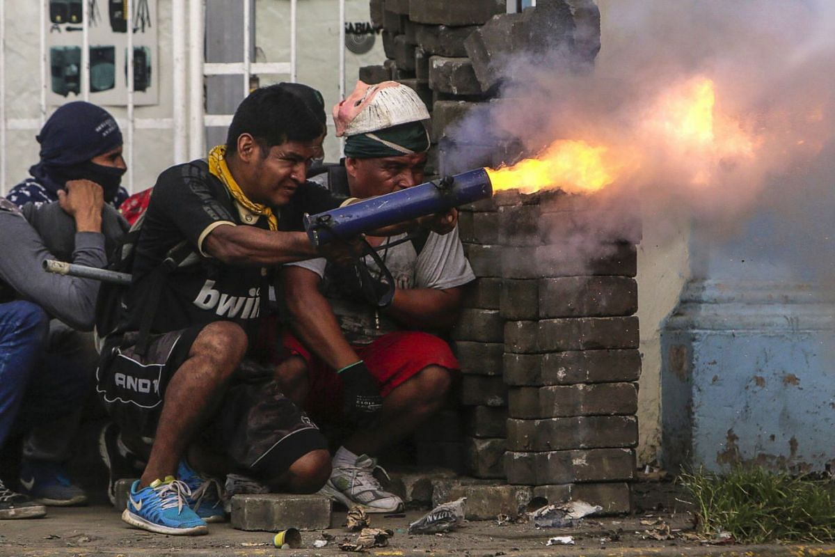 An anti-government demonstrator fires a home-made mortar during clashes with riot police at a barricade in the town of Masaya, 35 km from Managua on June 9, 2018. PHOTO: AFP