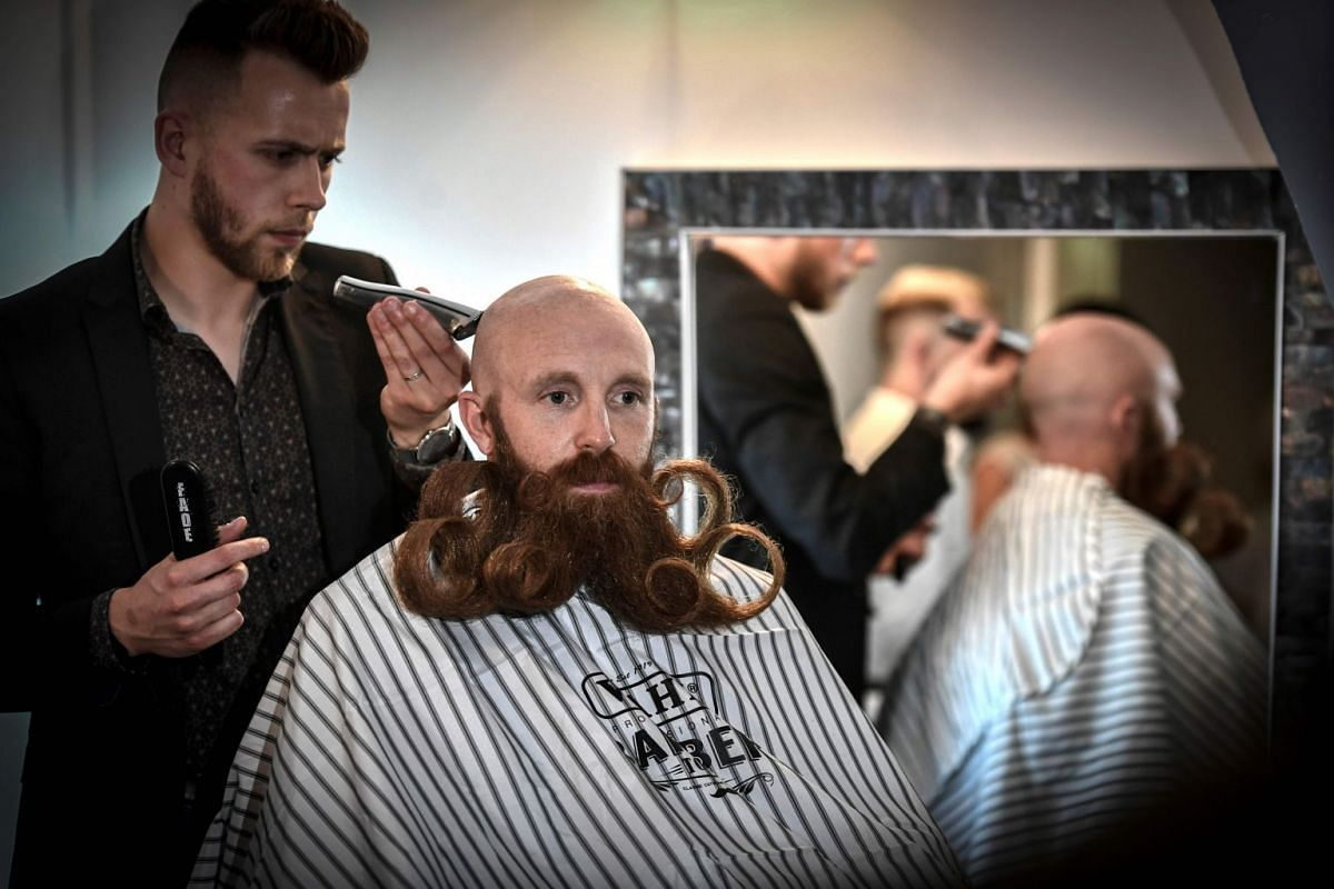 A participant is pictured during France Beard Championship on June 9, 2018 in Paris. PHOTO: AFP