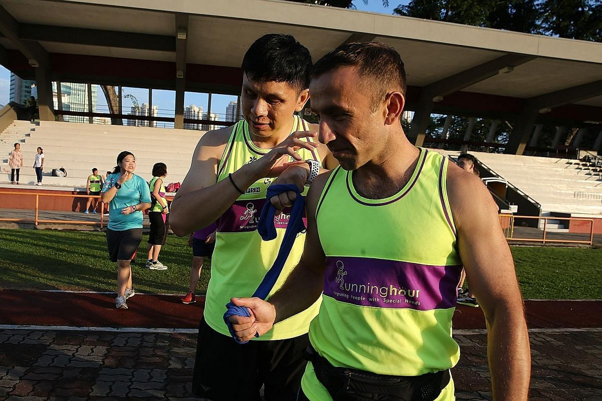 "Living up to Runninghour's motto of ""Run to bond, run so others can!"", polytechnic lecturer and running guide Wang Cuiling and visually-impaired office worker Fadiah Aman have been doing just that together for the third time. Here they are seen compl"