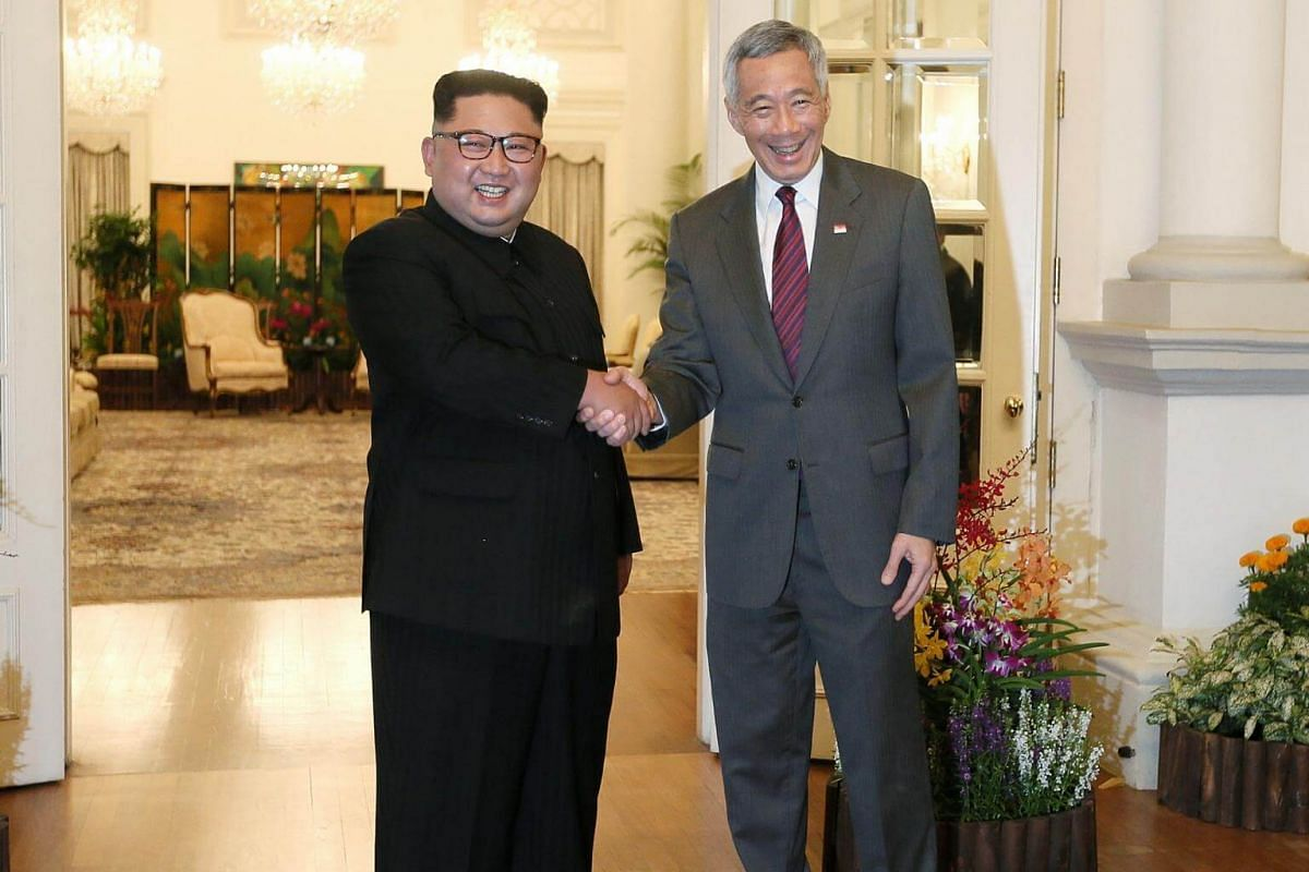 North Korean leader Kim Jong Un shaking hands with Prime Minister Lee Hsien Loong at the Istana, on June 10, 2018.