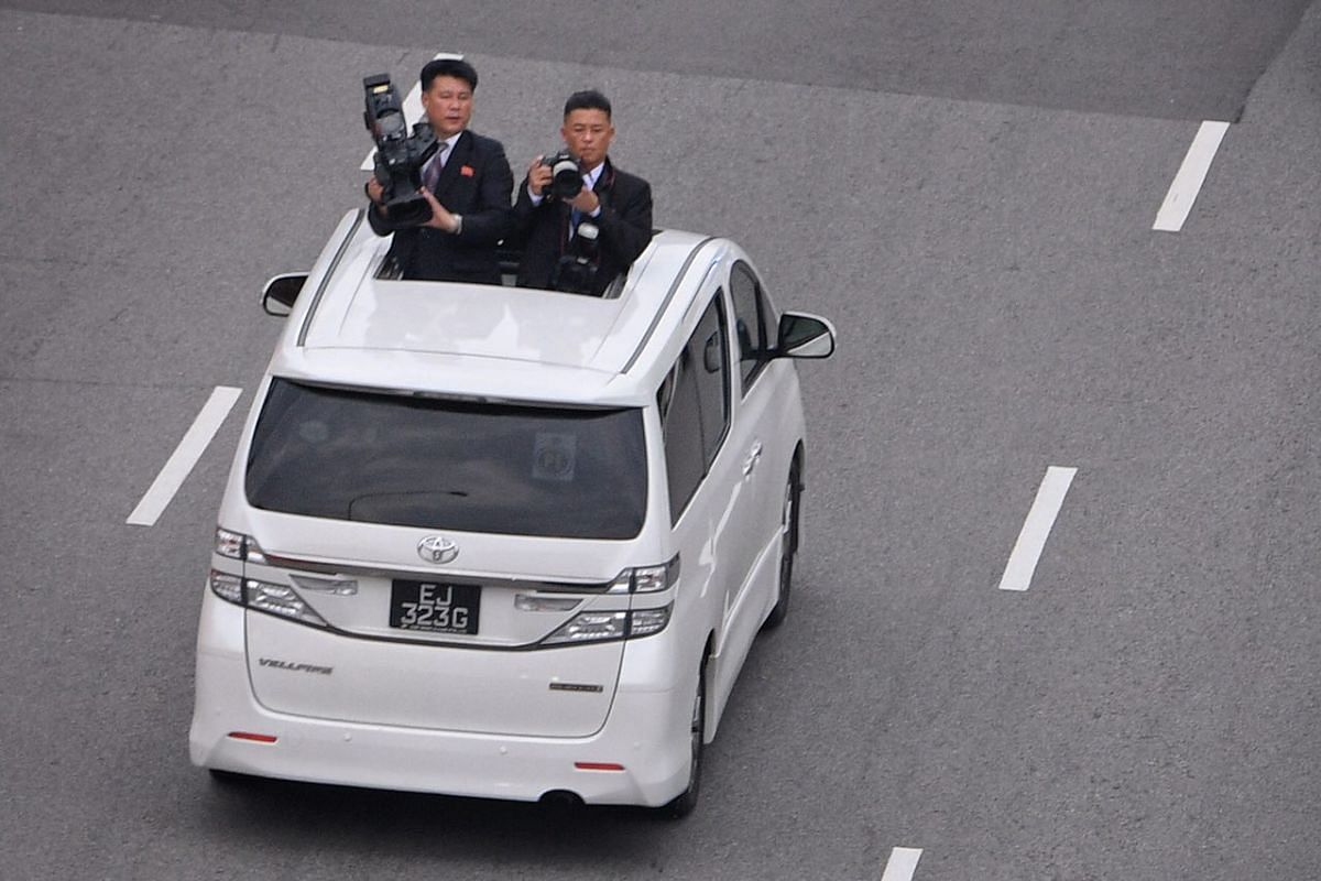 Members of the North Korean media film leader Kim Jong Un's convoy arriving in Sentosa along the Sentosa Gateway, as photographed from the Propeller Rooftop Bar at Bay Hotel Singapore.
