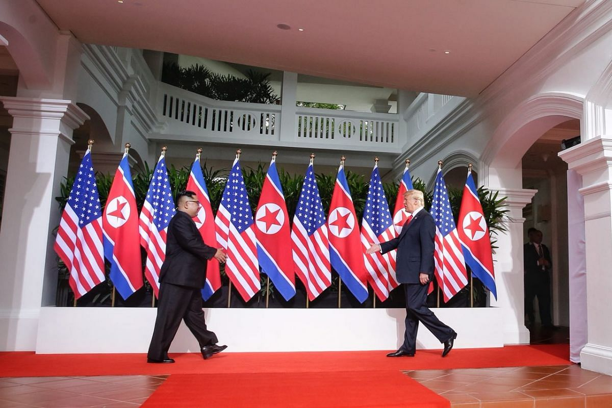 US President Donald Trump and North Korean leader Kim Jong Un approaching each other at the courtyard of Capella Singapore.