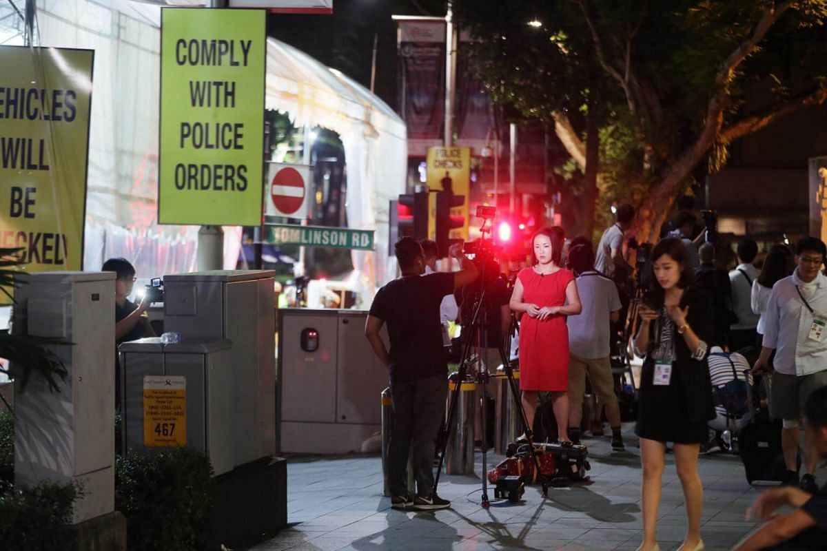 Journalists waiting for North Korean leader Kim Jong Un to leave The St Regis Singapore hotel on June 12, 2018.