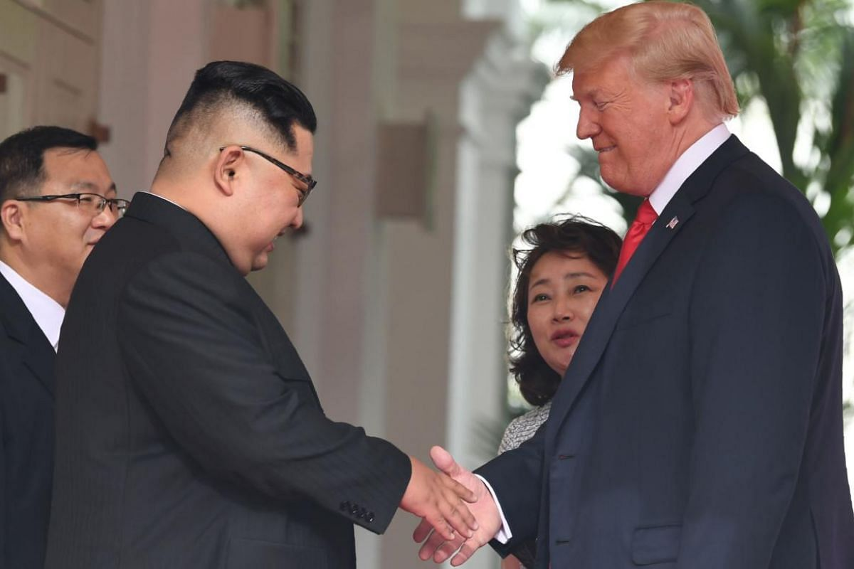 US President Donald Trump shaking hands with North Korean leader Kim Jong Un at Capella Singapore before their bilateral talks.