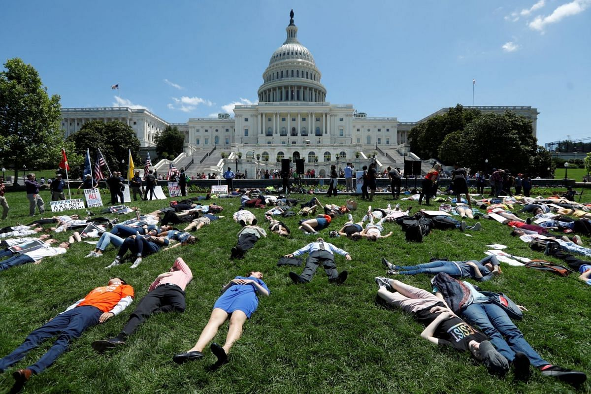 Activists mark the second anniversary of the Pulse Nightclub shooting where a gunman killed 49 people in Orlando with a die-in at the U.S. Capitol in Washington, U.S., June 12, 2018. PHOTO: REUTERS