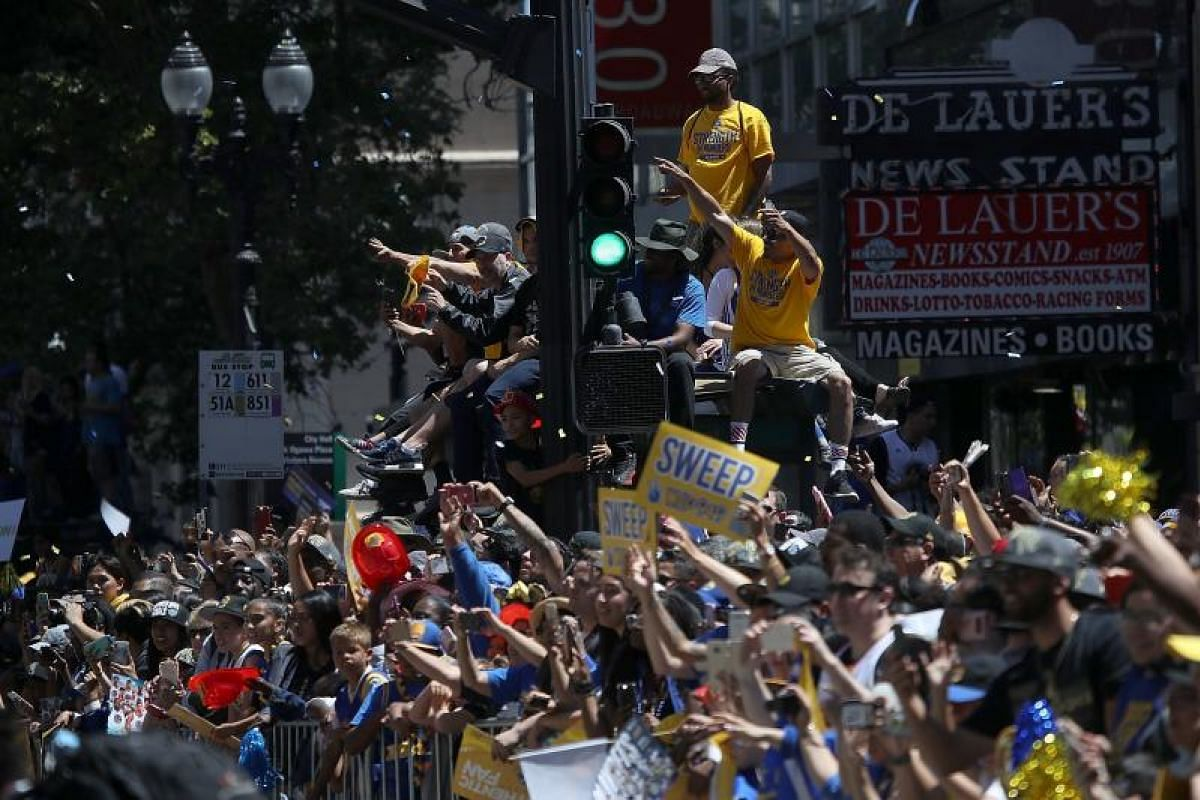 Golden State Warriors fans line the parade route during the Golden State Warriors Championship parade on June 12, 2018.