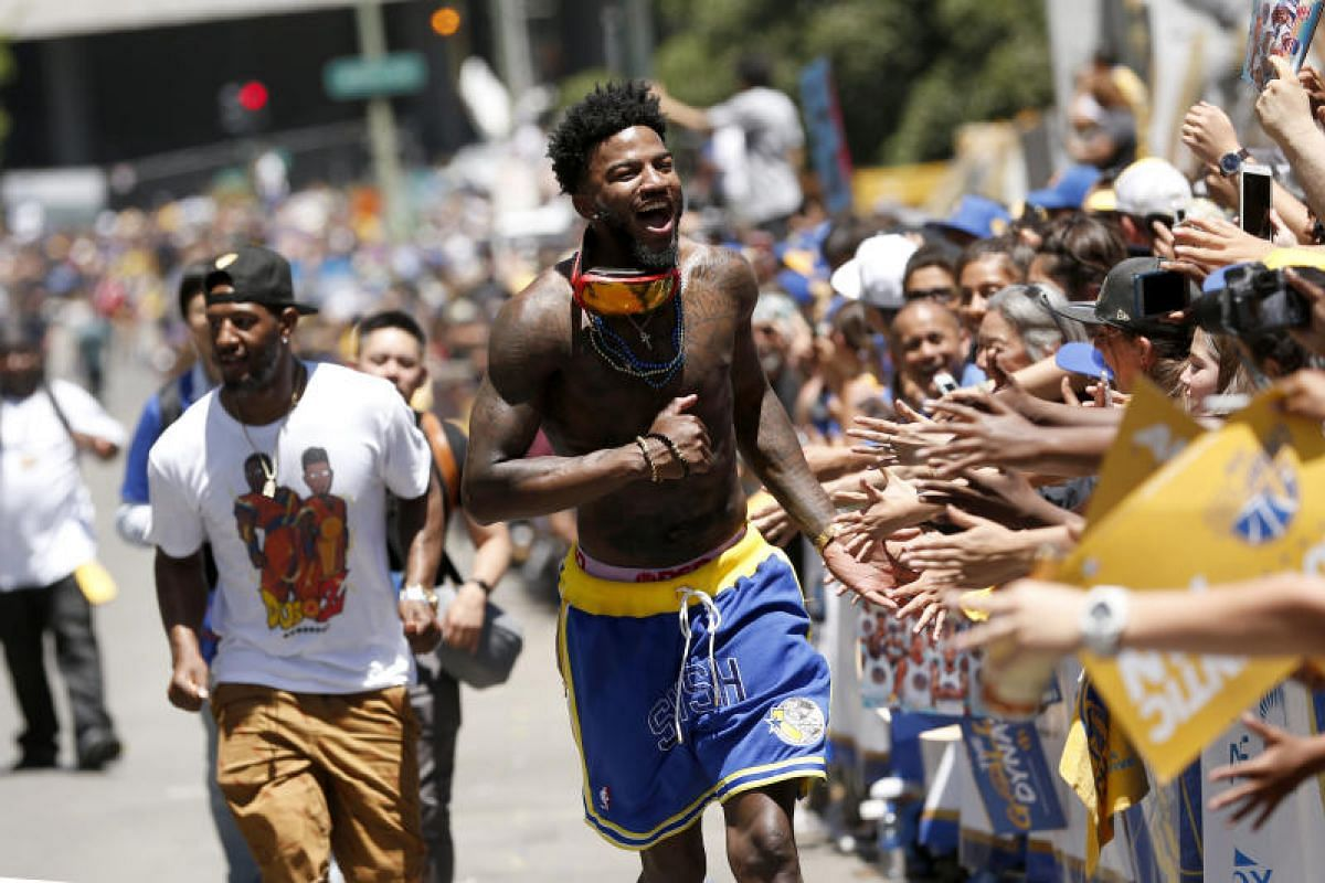 Golden State Warriors forward Jordan Bell interacts with fans during the Warriors 2018 championship victory parade in downtown Oakland, on June 12, 2018.