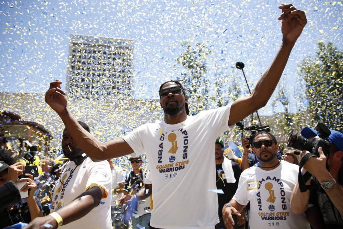 Golden State Warriors forward Kevin Durant interacts with fans during the Warriors 2018 championship victory parade in downtown Oakland, on June 12, 2018.