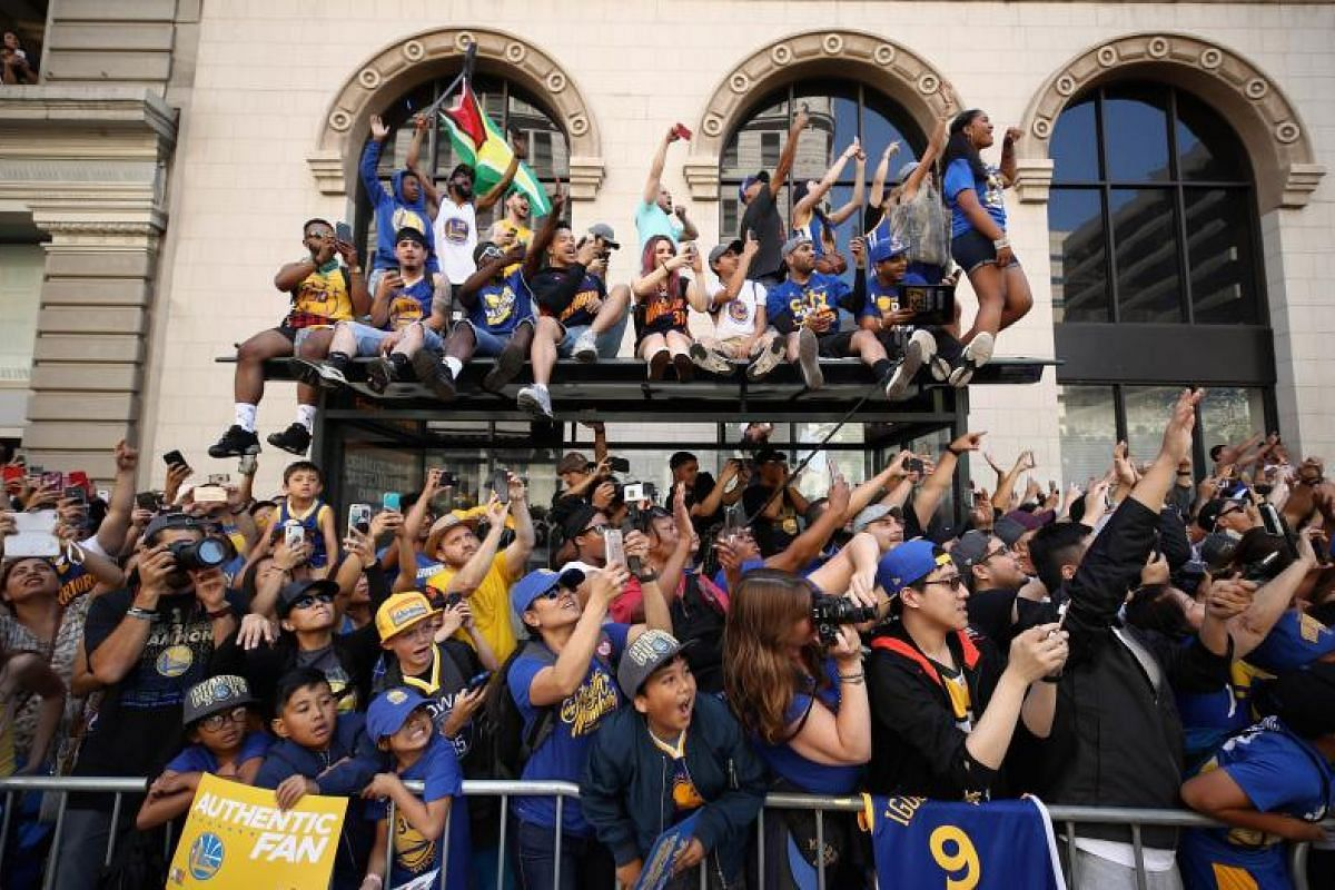 Fans cheer for the players during the Golden State Warriors Championship parade on June 12, 2018.